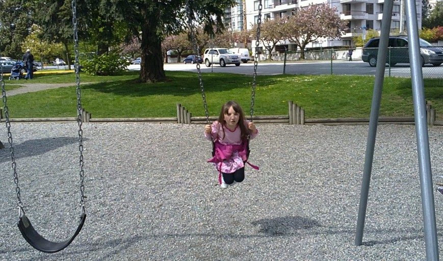The Girl, five years old, on a swing set